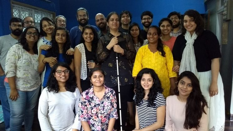 Ask Me; Don't Assume - Mumbai-October-2017: This is a group of photo of over 20 people posing together for the camera. Some are standing at the back and those in the front are sitting. The background walls are blue in colour.