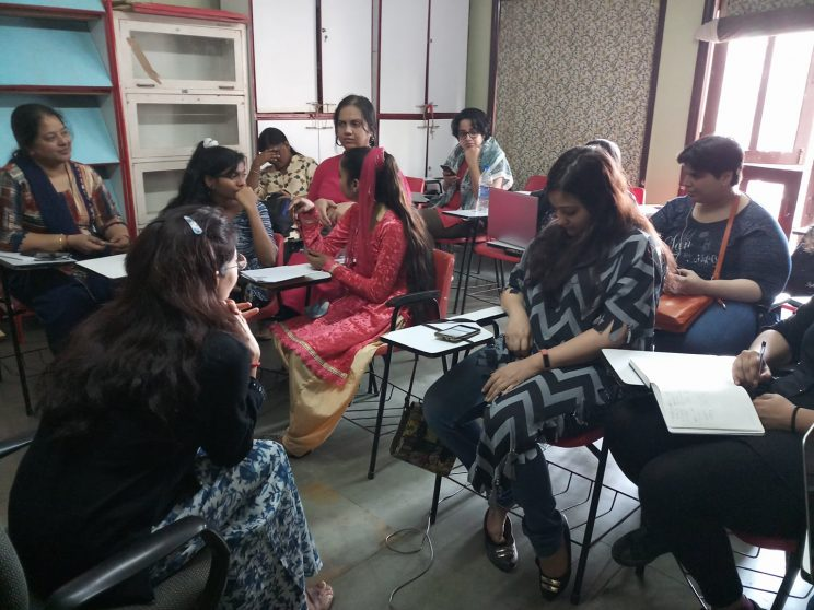My Tale Too - Mumbai-January-2018: Over 10 women, disabled and non disabled are sitting in a classroom setting and facing another woman who is the facilitator. They are talking to each other, some seem to be lost in thought and one is looking into her phone