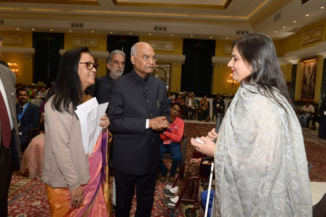 nidhi goyal smiling and talking to the president of india, ram nath kovind and shakuntala gamlin standing beside him at the rashtrapati bhavan
