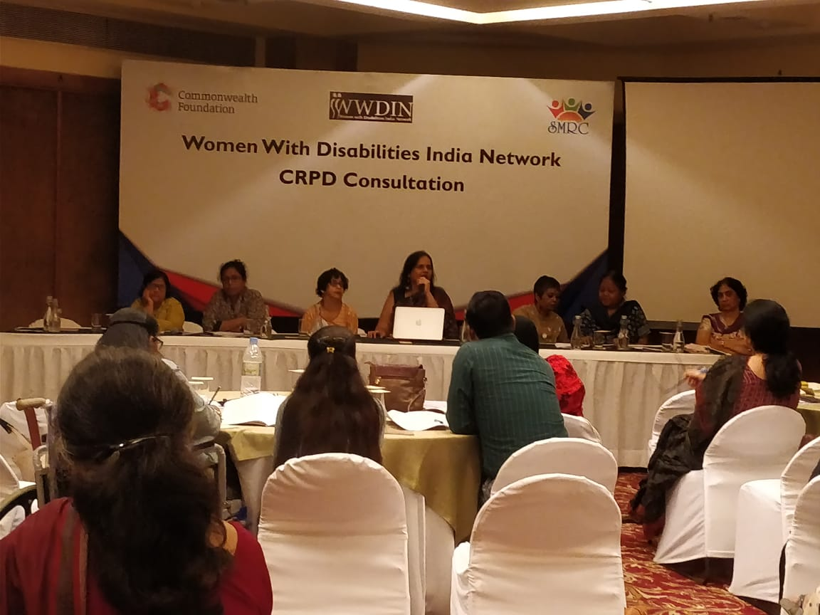 nandini ghosh, kuhu das, jeeja ghosh, nidhi goyal, ratnaboli ray, reena mohanty and sandhya limaye on a panel. behind them, the board reads women with disabilities india network crpd consultation
