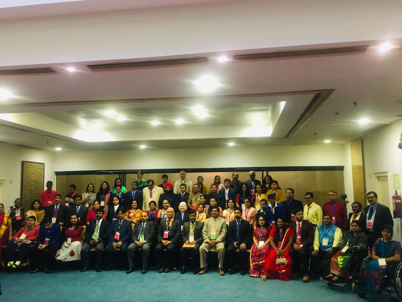 group photo of all winners of the national award for the empowerment of persons with disabilities 2019 with the vice president of india. nidhi goyal in the second last row