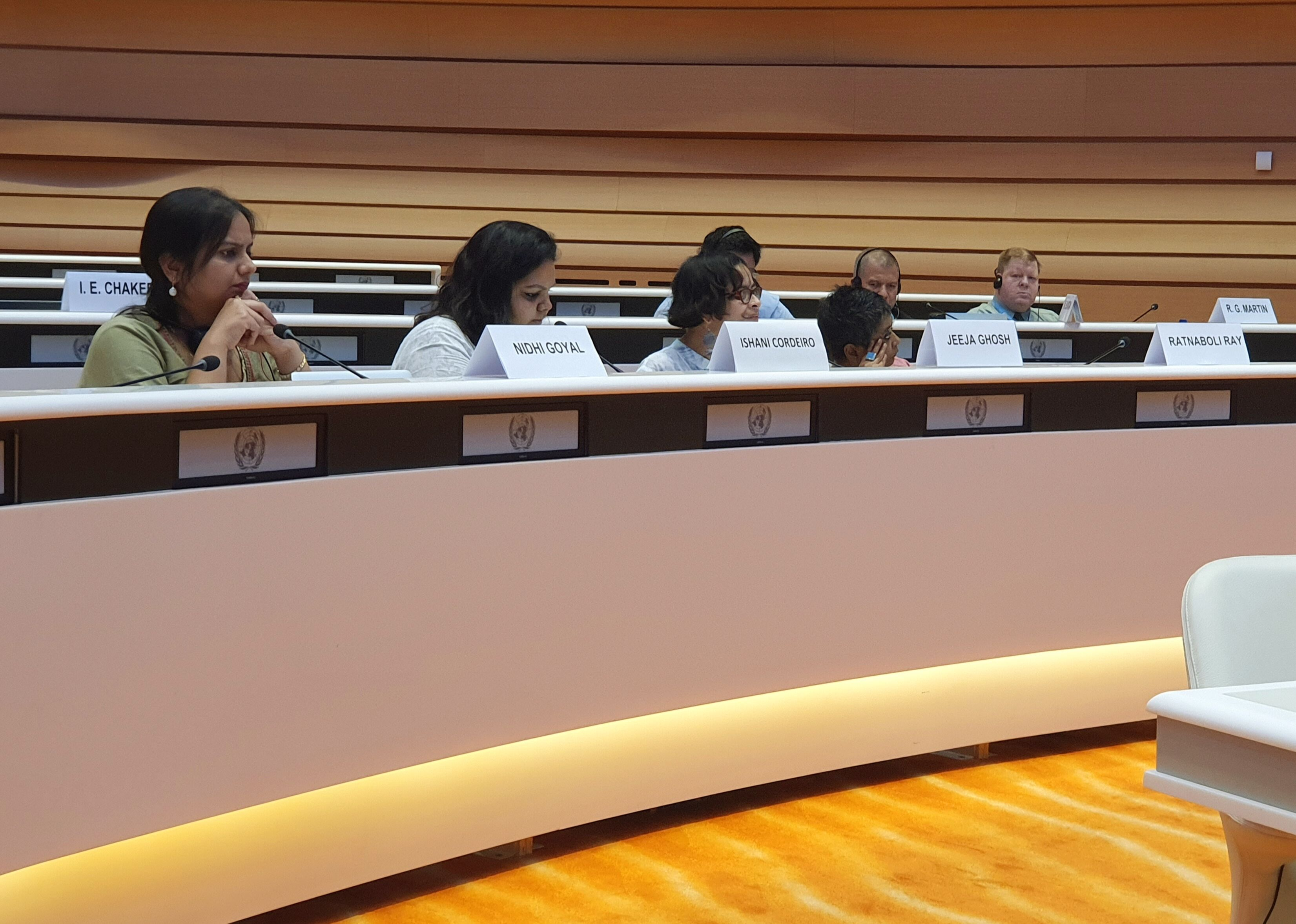 nidhi goyal, ishani cordero, jeeja ghosh and ratnaboli ray sit around a large table with their name tags in front of them at the UNCRPD reporting