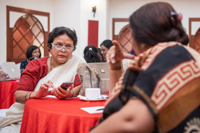 stuti kacker and jyotika kalra interacting at the table at lead grow change event in delhi