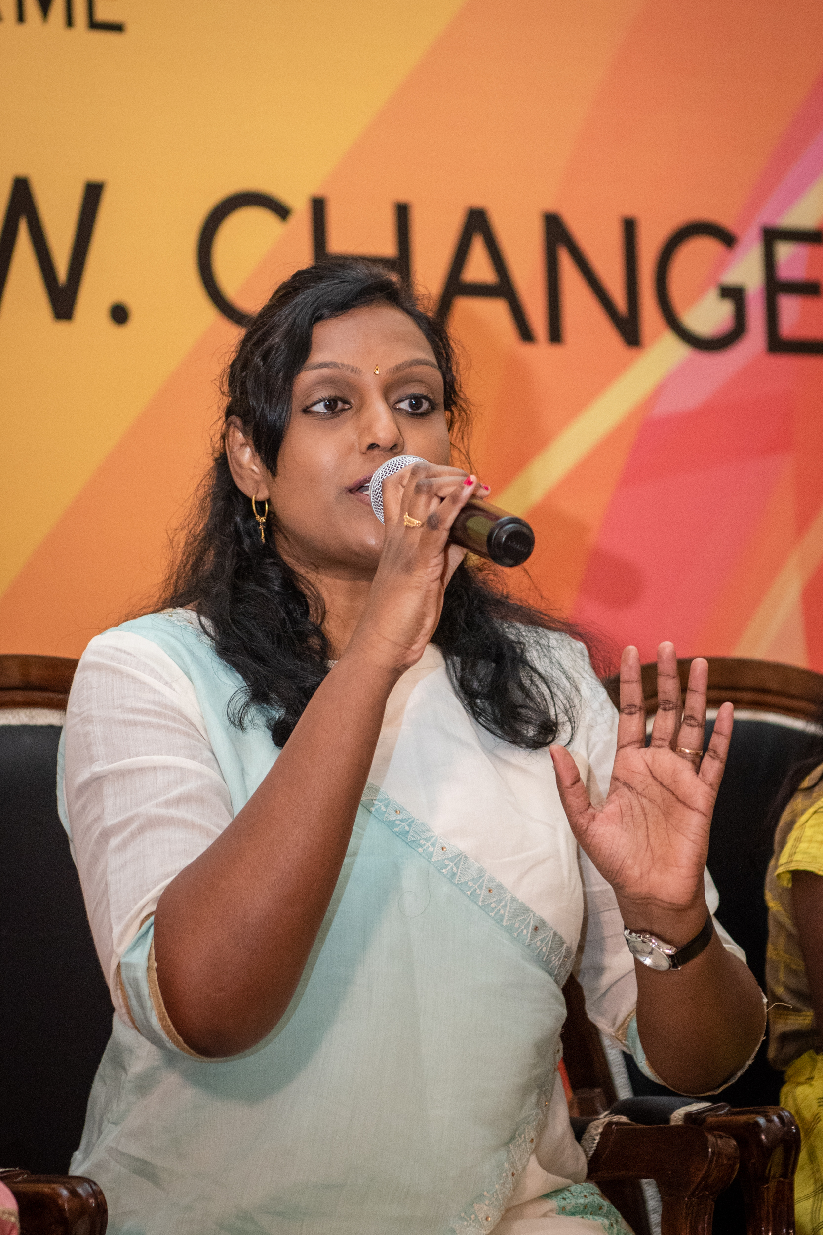 i can lead 2019 fellow asharani devaiah speaking on the mic at lead grow change in delhi