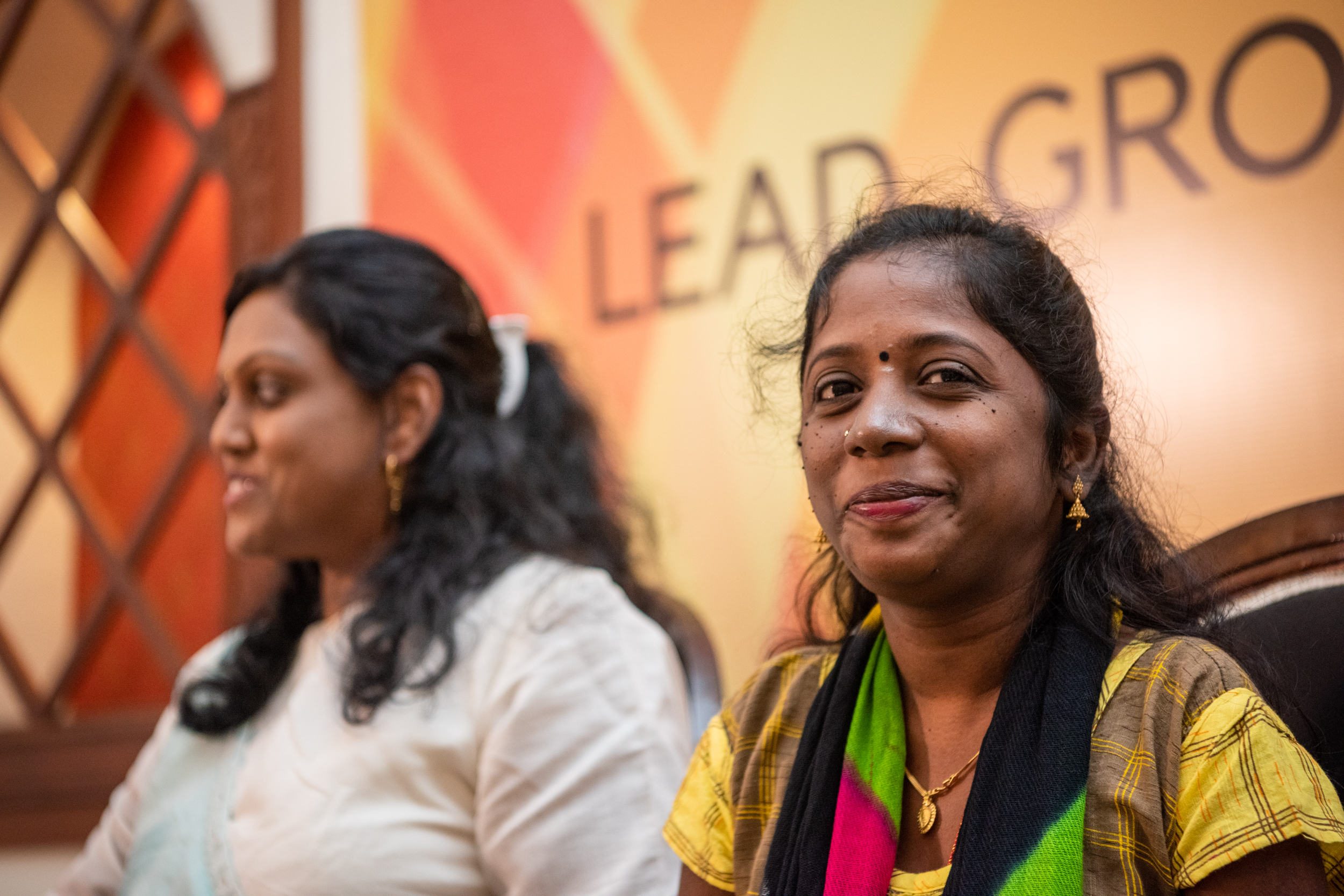 i can lead 2019 fellow nalini sagar smiling at the camera and asharani devaiah sitting next to her at lead grow change, delhi