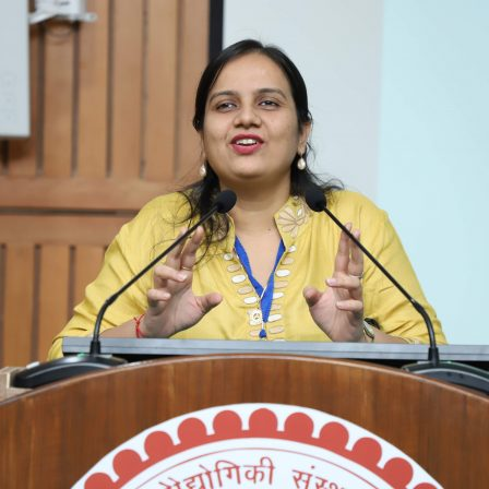 Nidhi goyal speaking at a podium